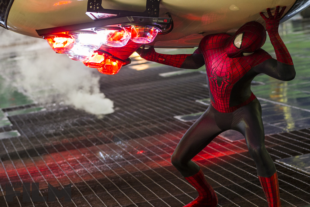 http://fansided.com/files/2014/01/The-Amazing-Spider-Man-2-Spidey-Holding-Up-Police-Car.jpg