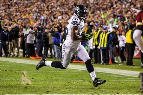 Jan 6, 2013; Landover, MD, USA; Seattle Seahawks fullback Michael Robinson (26) runs in for a touchdown after a catch during the second quarter of the NFC Wild Card playoff game against the Washington Redskins at FedEx Field. Mandatory Credit: Daniel Shirey-USA TODAY Sports