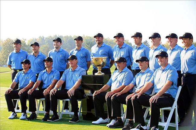 Oct 1, 2013; Dublin, OH, USA; Members of the International Team (back row) Mark McNulty , Richard Sterne , Branden Grace , Graham DeLaet , Brendan de Jonge , Nick Price , Hideki Matsuyama , Louis Oosthuizen , Tony Johnsstone , Shigeki Maruyama. Front row Jason Day , Adam Scott , Ernie Els , Angel Cabrera , Charl Schwartzel and Marc Leishman pose during a photo call on the practice ground prior to the start of The Presidents Cup at Muirfield Village Golf Club. Mandatory Credit: Allan Henry-USA TODAY Sports
