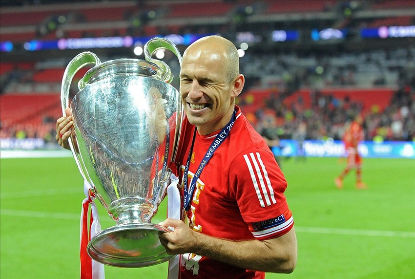 Lionel messi praises robin van persie and arjen robben may 25 2013 london united kingdom bayern munich player arjen robben celebrates with the trophy after the champions league final against borussia voltagebd Choice Image