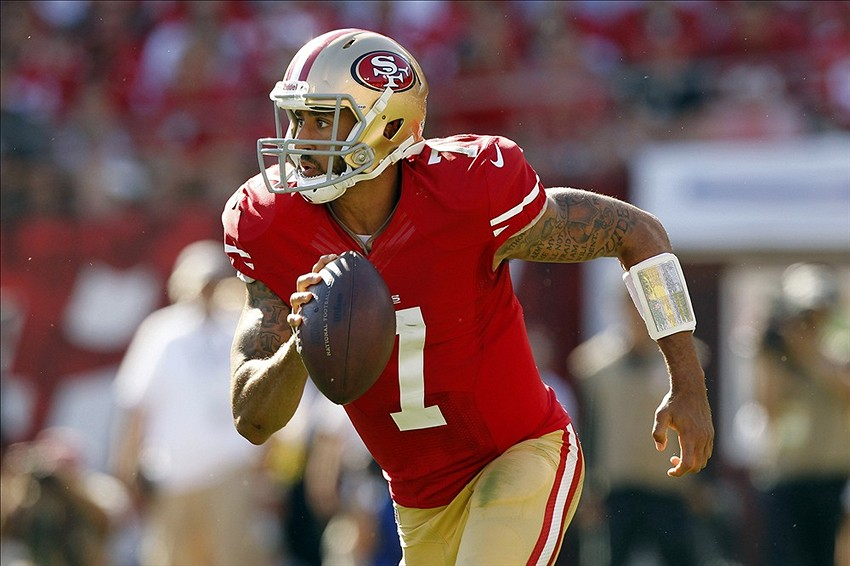 45f689abe Sep 8, 2013; San Francisco, CA, USA; San Francisco 49ers quarterback Colin  Kaepernick (7) runs with the ball against the Green Bay Packers in the  fourth ...