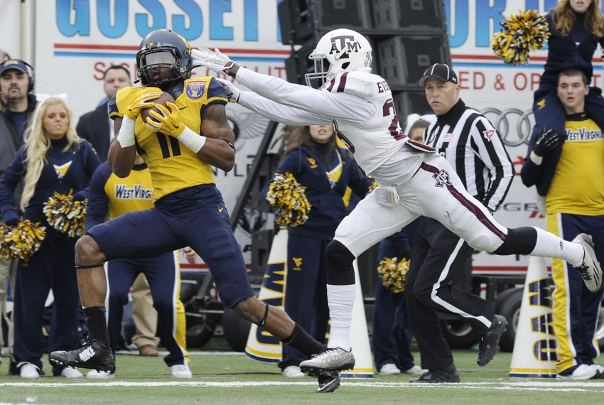 ... Mountaineers wide receiver Kevin White (11) catches a pass while  defended by Texas A M Aggies defensive back Deshazor Everett (29) during  the game in ... 8e56517e0