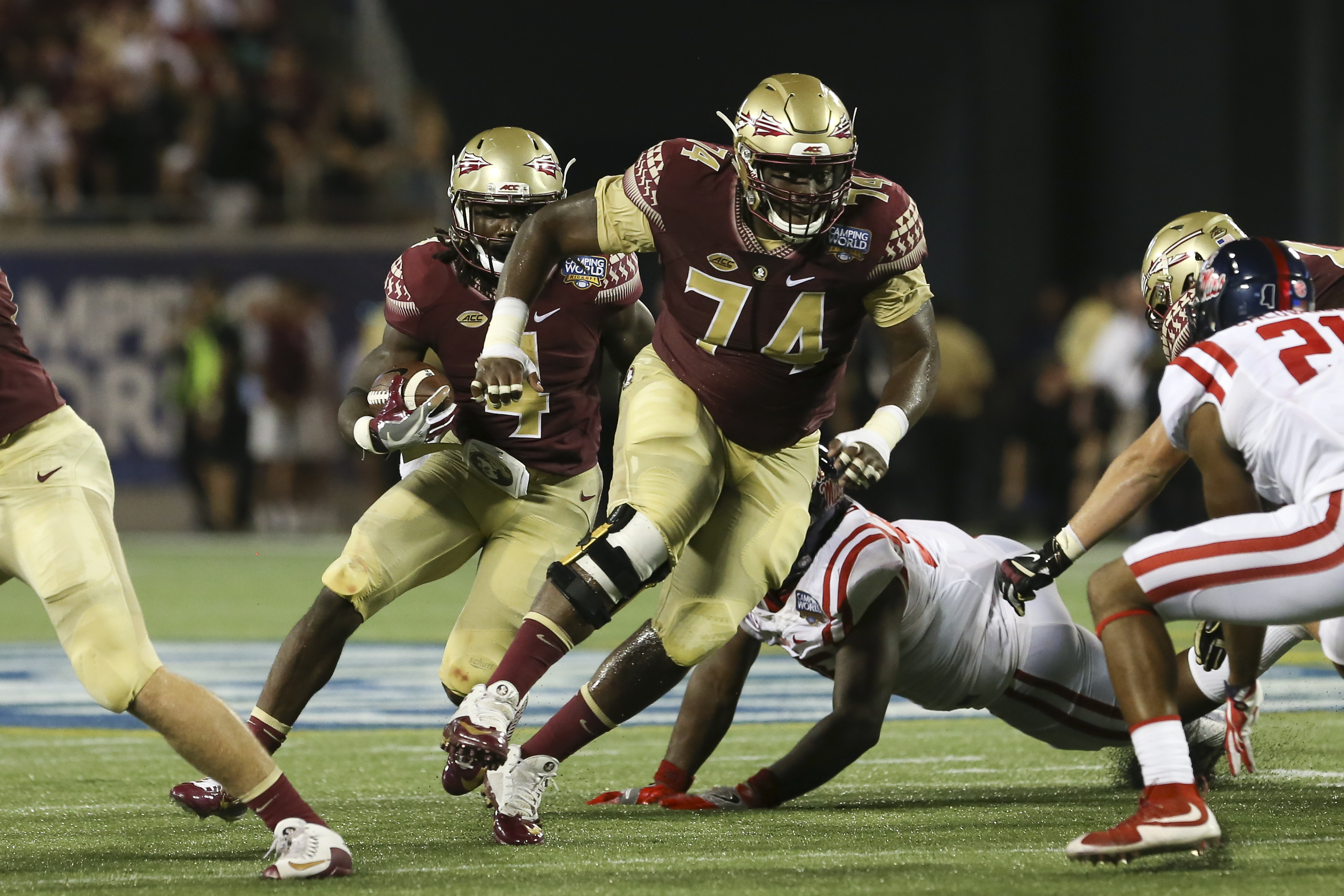 2017 05 kickoff time for national championship game - 05 September 2016 Florida State Seminoles Offensive Lineman Derrick Kelly Ii 74 Blocks For Florida State Seminoles Running Back Dalvin Cook 4 During