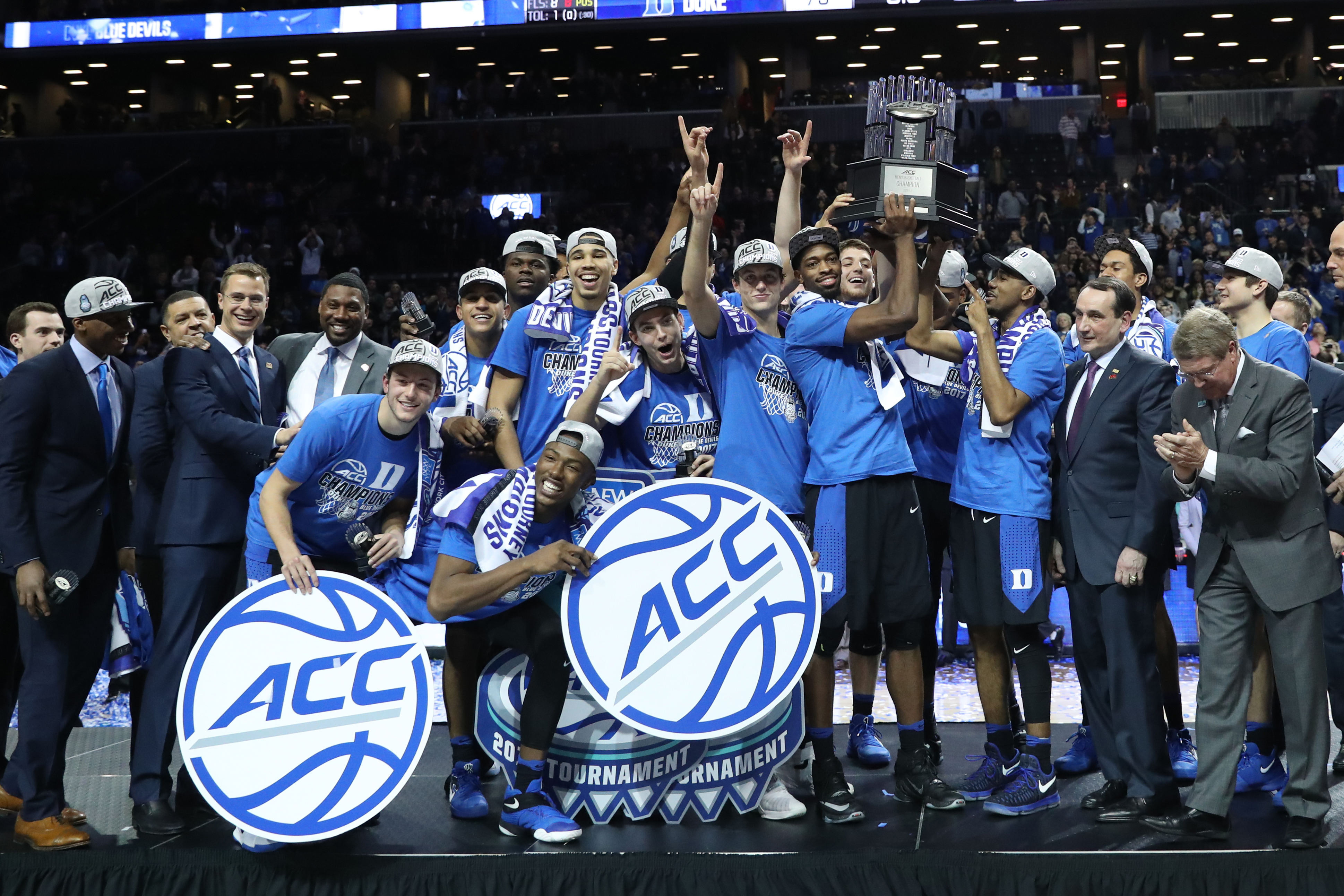 mar 11 2017 brooklyn ny usa duke blue devils players hold the championship trophy after defeating against the notre dame fighting irish during the acc